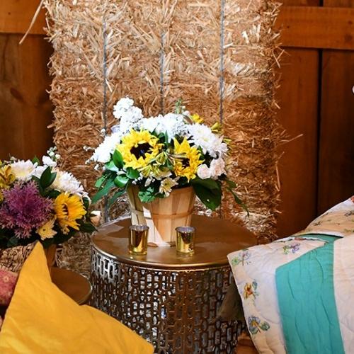 flower basket on side table at reception