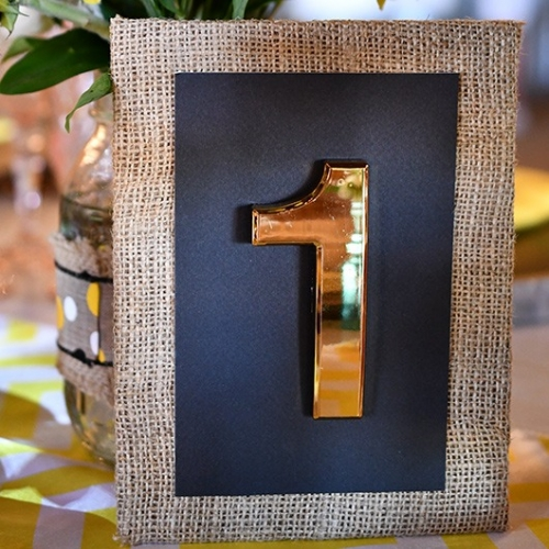 gold table number with burlap