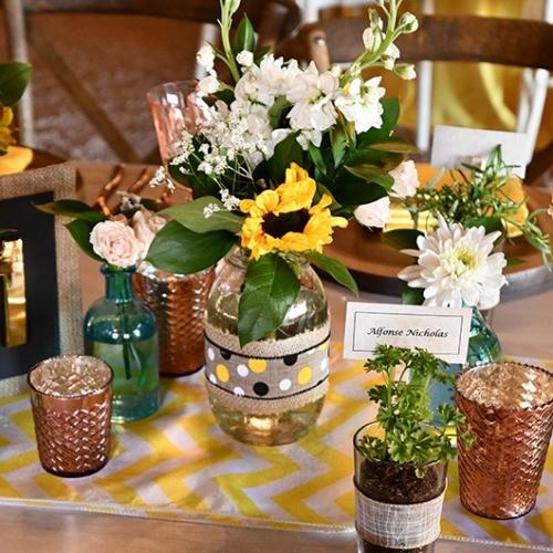 mason jar with flower on reception table