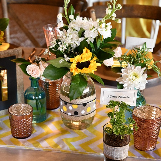 mason jar with flower on reception table