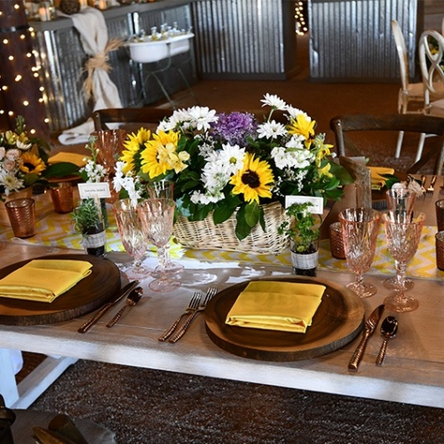 oval basket on wedding reception table with flowers