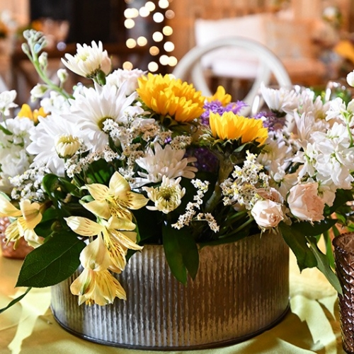 round tin with flower arrangement