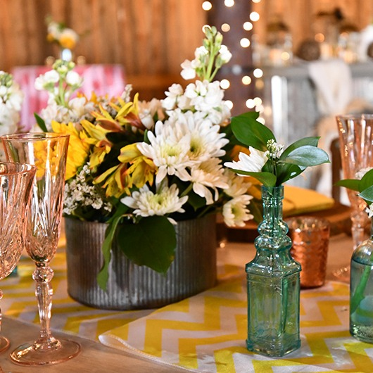 small round tin to hold flowers at reception table
