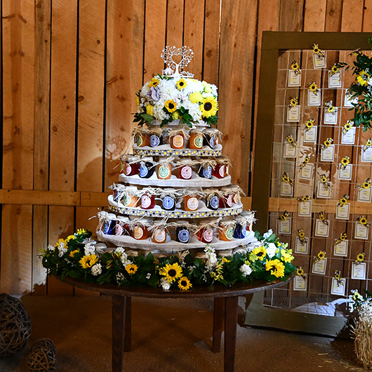 wedding cake with jars of jam