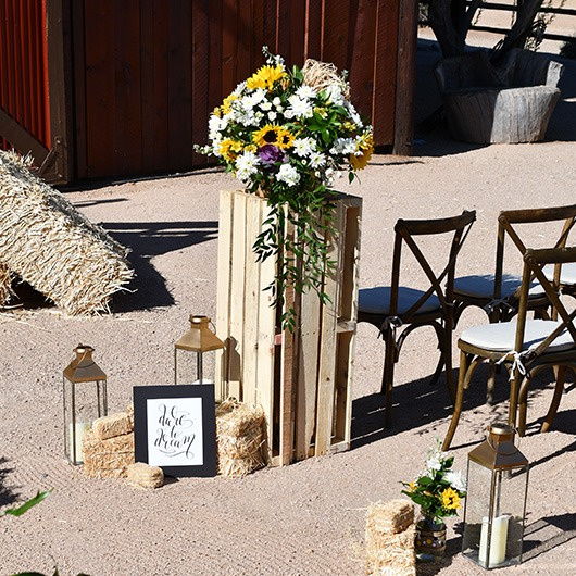 wooden pallet pedestal with flowers displayed